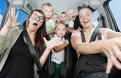 pic of car ride  - Crazy mothers with her children riding to holidays - JPG