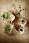 stock photo of cord  - Rustic hemp cord spool with natural style handcrafted gift boxes - JPG