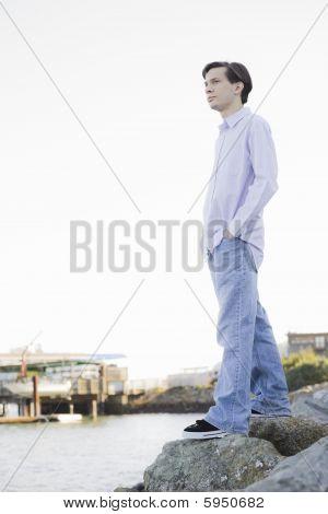 Teenage Boy Looking At Ocean