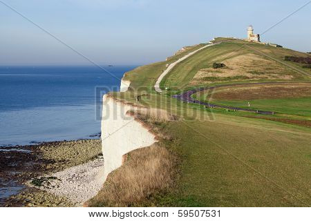 Lighthouse On A Green Hill Overlooking The Sea