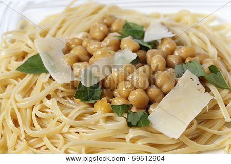 Bavette pasta, almost identical to linguine, served with a chickpea, garlic, chili and parmesan sauce, and garnished with torn basil leaves