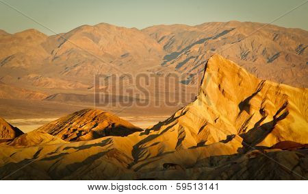 Zabriskie Point surrounded by a maze of vibrantly yellow badlands