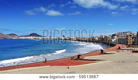 LAS PALMAS, SPAIN - OCTOBER 17: View of Las Canteras Beach on October 17, 2013 in Las Palmas de Gran Canaria, Spain. Due to the tropical weather, the locals can go to the beach almost all year