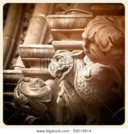 A grotesque of a bird carved on the exterior of a Cathedral in Edinburgh, Scotland. Filtered to look like an aged instant photo.