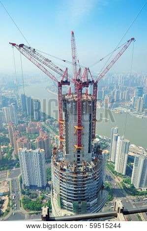 SHANGHAI, CHINA - JUNE 2: Skyscraper under construction on JUNE 2, 2012 in Shanghai, China. Shanghai is the largest city by population in the world with 23 million as in 2010 and is still growing.