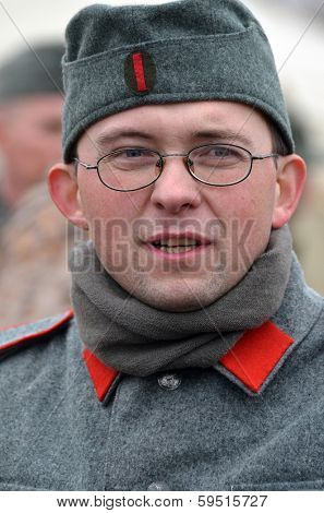 KIEV, UKRAINE -NOV 2:An unidentified member of Red Star history club wears historical Belarussian collaborationist Police uniform during historical reenactment of WWII, November 2, 2013.Kiev, Ukraine