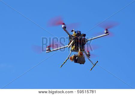 KIEV, UKRAINE -NOV 3: Quadrocopter drone flies with mounted digital camera during historical reenactment of WWII, Dnepr river crossing 1943, November 3, 2013 . Kiev, Ukraine