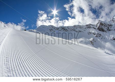 perfectly groomed empty ski piste