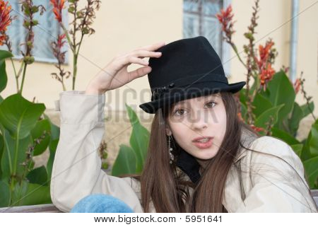 Young Beautiful Girl In A Trilby Hat