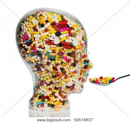 a head made of glass filled with many tablets. photo icon for drugs, abuse and addiction tablets.