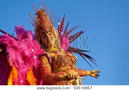 Sesimbra, Portugal - February 12, 2013: Brazilian Samba dancer in full costume parading in the Float-Car in the Brazilian Carnival parade on Feb/12/2013 in Sesimbra, Portugal
