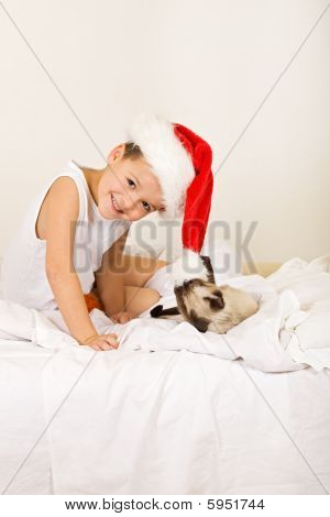 Girl With Her Cat Waiting For Christmas