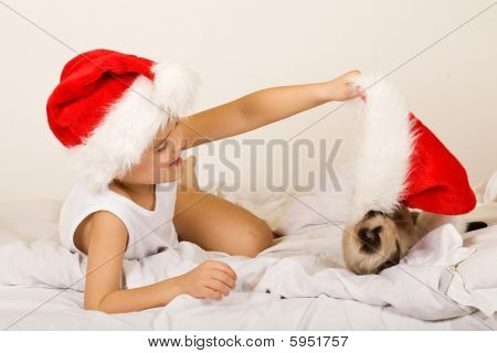 Girl Playing With Her Cat On Christmas Eve
