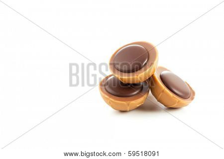 Caramel candies with nougat cream and dark chocolate