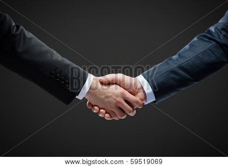 Close up shot of handshake of business people. Concept of trustworthy relations and business cooperation