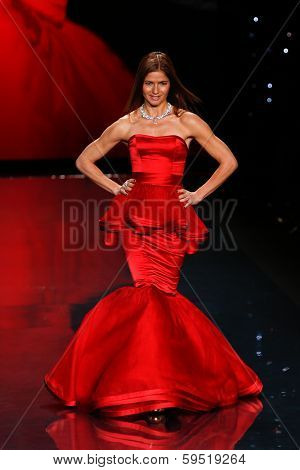 NEW YORK-FEB 6: Jill Hennessy wears Dennis Basso on the runway at The Heart Truth Red Dress Collection show during Mercedes-Benz Fashion Week at Lincoln Center on February 6, 2014 in New York City.