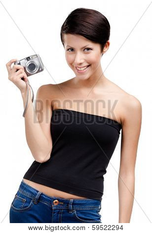 Creative girl holds amateur hand-held  silver camera, isolated on white