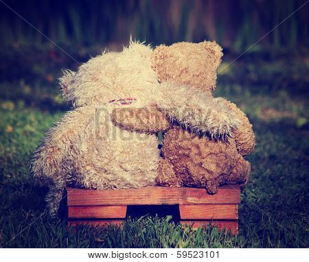 two teddy bears on a bench with arms around each other with a retro vintage instagram filter