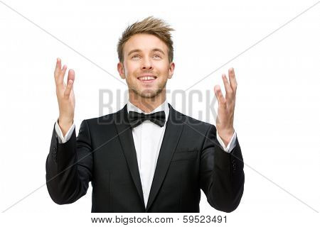 Half-length portrait of businessman praying with hands up, isolated on white. Concept of hope and belief