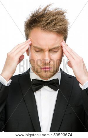 Portrait of business man with closed eyes putting hands on head, isolated on white. Concept of headache and high temperature
