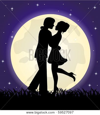 silhouettes of a loving couple standing in front of the moon