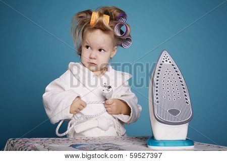 cute little housewife with iron