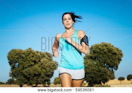 Sweaty Woman Running Cross Trail