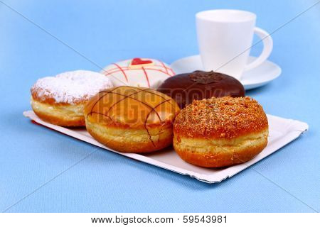 Five Delicious, Assorted Donuts With Coffee Cup