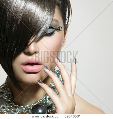 Fashion Model Girl Portrait. Fringe Hair Style. Short Haircut. Hairstyle. Beauty Woman closeup. Fringe. Hairdressing. Silver Metallic Accessories and Manicure