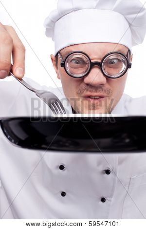 chef holding pan and fork isolated on white background