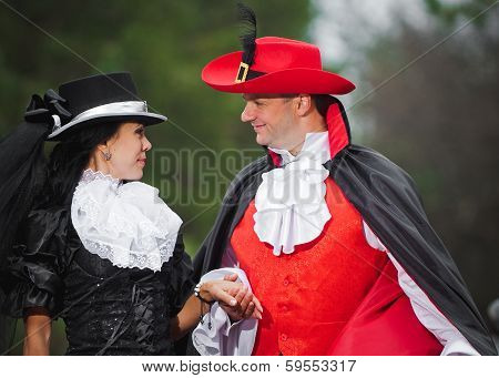 Man And Woman In Costume