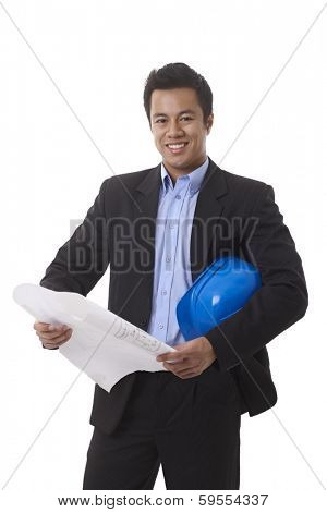 Happy smiling Asian architect holding floor plan and hardhat, looking at camera.