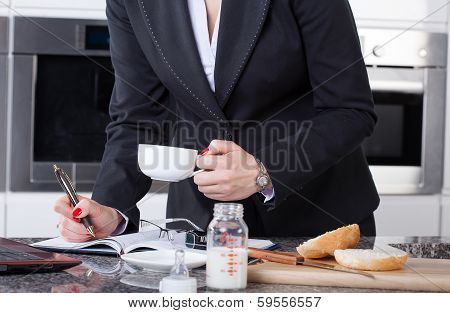 Multitasking Woman In Kitchen
