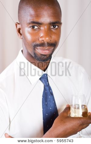 Businessman drinking wine