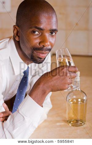 Businessman drinking wine