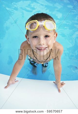 a young boy in a blow up pool