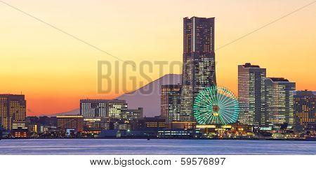 Yokohama city skyline over the Mt  Fuji at sunset time