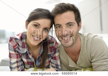 Portrait of cute young couple relaxing at home