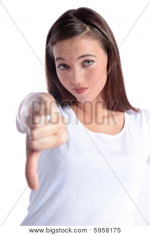 Attractive young woman making negative gesture