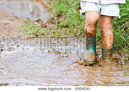 Child Playing in Mud