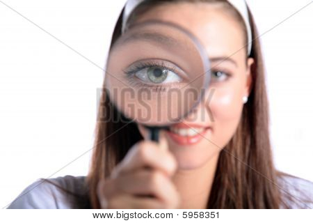 Attractive young woman using a magnifier