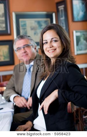 Young and senior business people