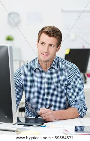 Handsome Businessman Working At His Desktop