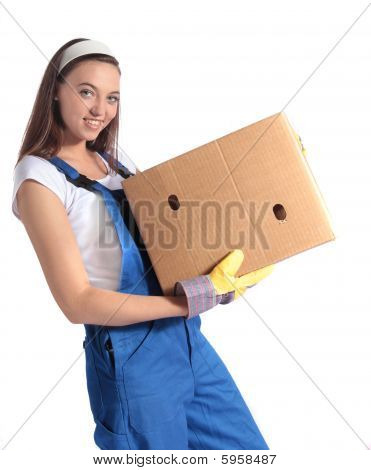 Young woman carrying moving box