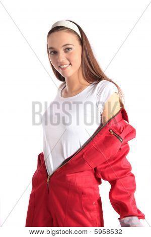 Attractive mechanic undresses her overall