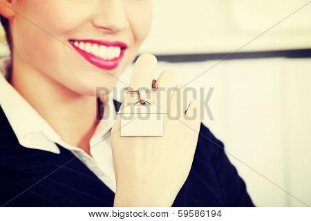 Closeup on key breloque on woman`s palm