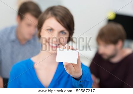 Friendly Businesswoman Holding Up A Blank Card