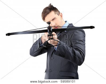 Young businessman with crossbow, isolated on white