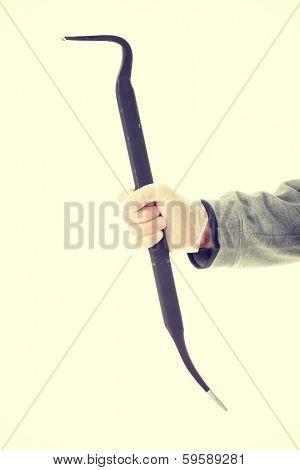 Criminal theme - thug hand with a crowbar