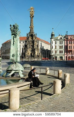 OLOMOUC, CZECH REPUBLIC CIRCA MAY 2005 - Unknown nun sitting on the edge of the fountain